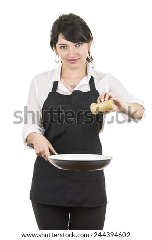young beautiful female chef wearing black apron cooking holding a pan isolated on white - stock photo