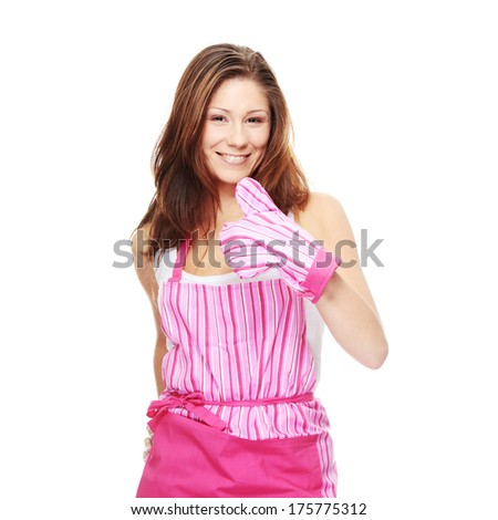 Young beautiful female cook, isolated on white - stock photo