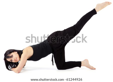 Young beautiful female doing legs stretching workout,  looking at camera