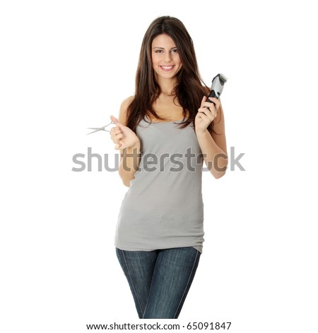 Young beautiful female hairdresser holding scissors and hair clipper, isolated on white - stock photo