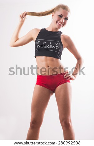 young beautiful female in fitness sports clothing, with sweat. Athletic woman - stock photo