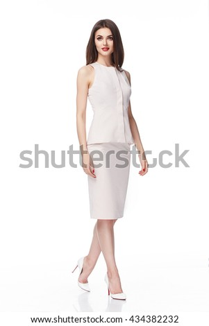 Young beautiful female model in white dress on white background studio woman brunette hair makeup body shape clothes collection summer office style casual party every day fashion sexy - stock photo
