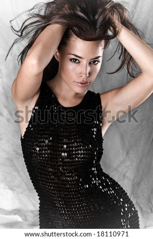 young beautiful female model with long flying hair, studio shot - stock photo