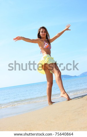 Young beautiful fit woman posing at the beach