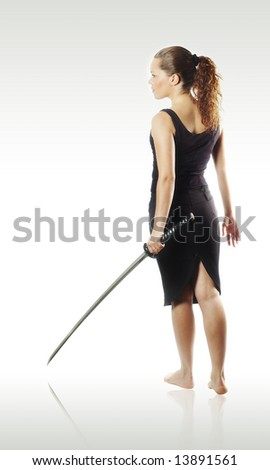 young beautiful girl and katana - stock photo