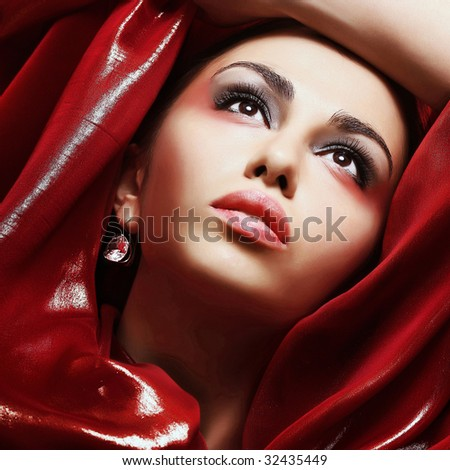 Young beautiful girl and make-up professionally done - stock photo