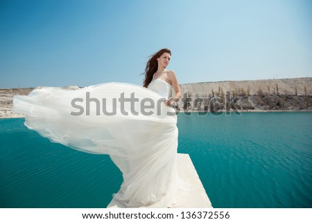 young beautiful girl bride on the beach