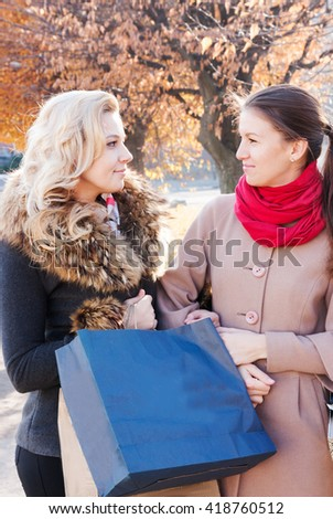 Young beautiful girl brunette and blonde  with shopping small town - stock photo