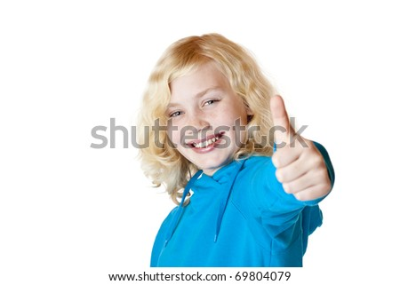 Young beautiful girl / child shows thumb up. Isolated on white background. - stock photo