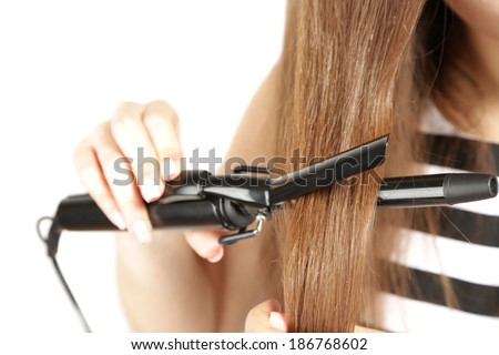 Young beautiful girl doing hairstyle, close up, isolated on white