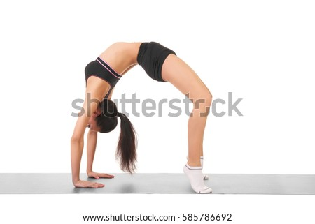 young beautiful girl doing stretching on a white background