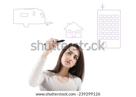 Young beautiful girl drawing house, trailer and apartment house isolated on white background. Home, sweet home. Thinking about the future. - stock photo