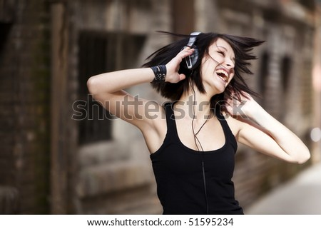 Young beautiful girl happy and dancing - stock photo