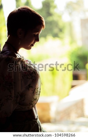 Young beautiful girl in a sad moment. - stock photo