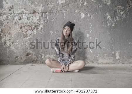 Young beautiful girl in abandoned house