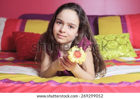 Young beautiful girl in bedroom - stock photo