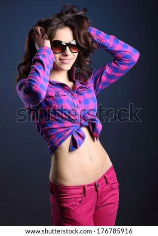 Young  beautiful girl in jeans.