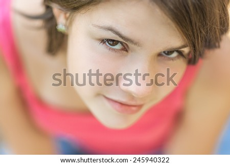 Young beautiful girl in red vest, close-up. - stock photo