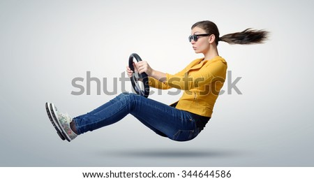 Young beautiful girl in sunglasses driver car with a wheel, auto concept - stock photo
