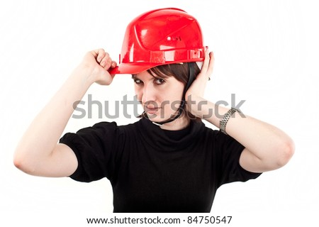 young beautiful girl in the construction helmet, isolated over white