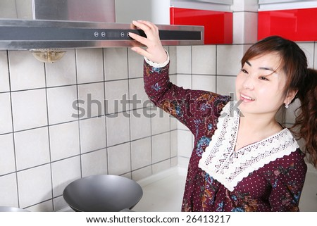 young beautiful girl in the kitchen
