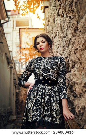 Young beautiful girl in the old courtyard - stock photo