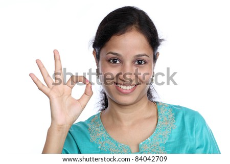 Young beautiful girl making Ok sign - stock photo