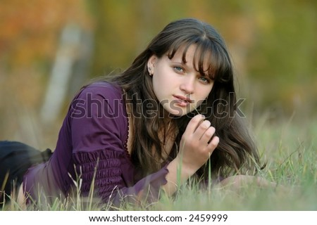 young beautiful girl on a glade