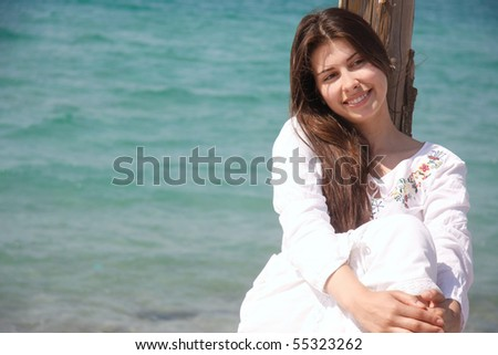 young beautiful girl on sea background - stock photo