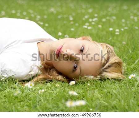 Young beautiful girl on the grass