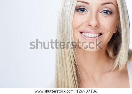 Young beautiful girl on white background
