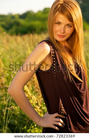 Young beautiful girl outdoor on the field - stock photo