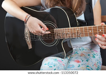 young beautiful girl playing guitar - stock photo