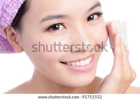 Young Beautiful Girl remove makeup by Cleansing Cotton isolated on white background, Model is a asian Beauty