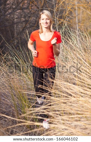 Young beautiful girl running in the countryside.  - stock photo