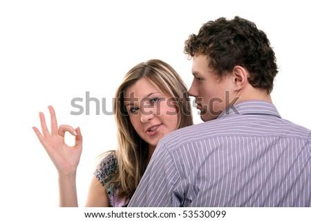 young beautiful girl showing OK sign near her boyfriend - stock photo