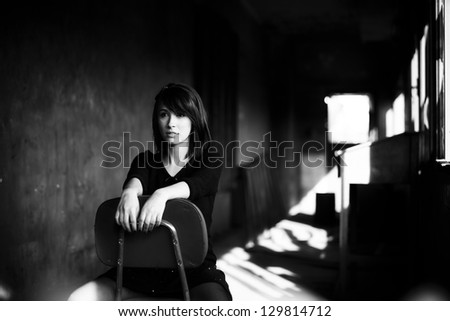 Young beautiful girl smiling cheerfully at you. - stock photo