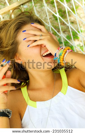 young beautiful girl smokes - stock photo