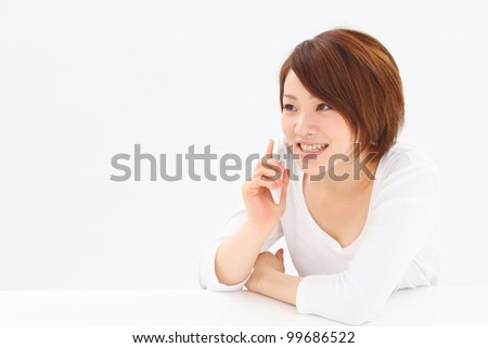 young beautiful girl using mobile phone - stock photo