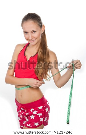 young beautiful girl with a measuring tape,centimeter, a fitness model, woman lose weight, beauty, isolated over white