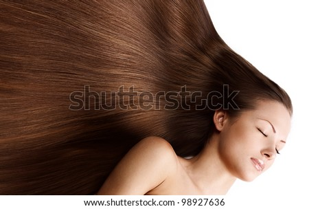 young beautiful girl with beautiful long brown healthy shiny hair - stock photo