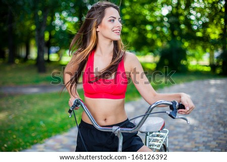 young beautiful girl with bike outdoor