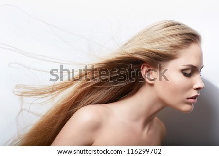 Young beautiful girl with flying hair - stock photo