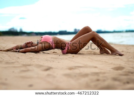 young beautiful girl with long hair on the beach