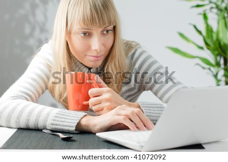 young beautiful girl with notebook and cup of drink