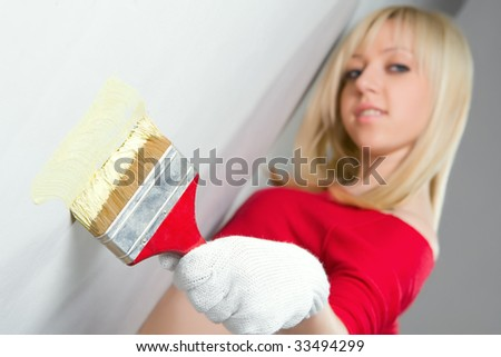 Young beautiful girl with paint brush