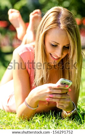 Young beautiful girl with phone - stock photo