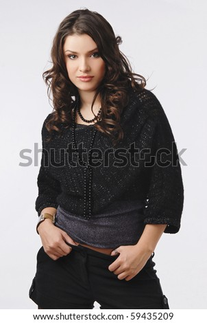 young beautiful girl with positive expression in studio shooting - stock photo