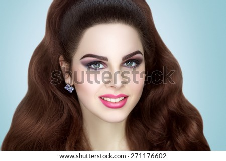 Young beautiful girl, woman, model, actress, bride. Flawless, perfect makeup for holiday, party, club. Expressive eyebrows, eyes, pink lips. Stylish attractive look. Chic hairstyle, wavy hair.