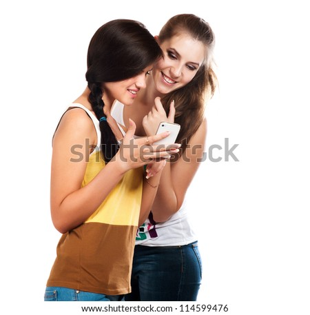 young beautiful girls using the cellphone to send and receive sms - stock photo